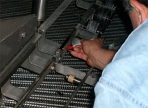 Omar Associates Expert checking a machine